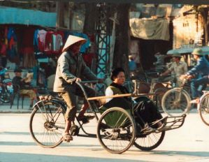 A fat woman in a rickshaw in Hanoi, 1989