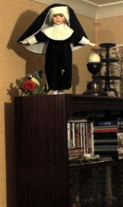 Flying nun or Satanic Chucky doll?