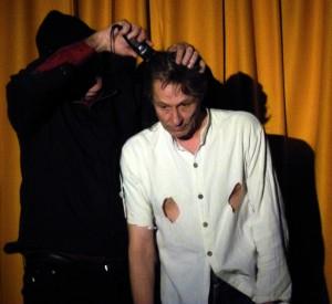 Stephen Frost (left) attacks Martin Soan's hair