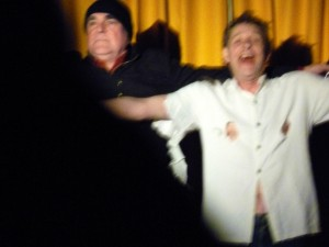 Triumphant Martin Soan obscured by cheering audience member