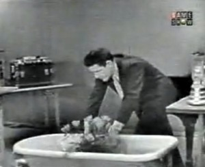 John Cage puts flowers into a bathtub of water