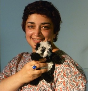 Sameena with a cuddly friend; without any sharp machete