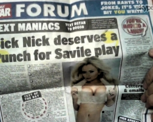Nick holds up a Daily Star double spread via Skype