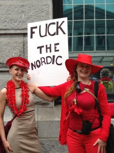 Red protest included Anna Smith (right) Photo by Kerry Porth