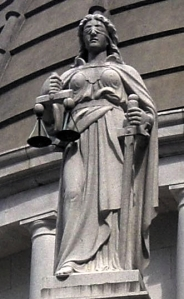 The figure of Justice - blindfolded to avoid seeing any truths