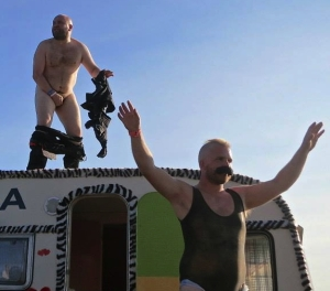 Bob Slayer (left), naked atop a Norwegian caravan