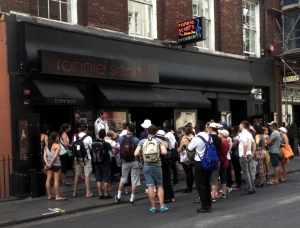 Tourists crowded round bricks in London