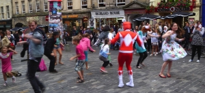 Juliette Burton (right) and her flash mob yesterday in the High Street