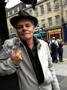 Noel Faulkner trying to give away £20 notes