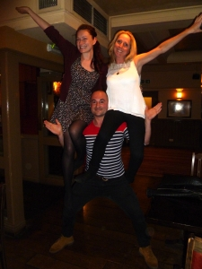 Adam, last night, lifting two ladies