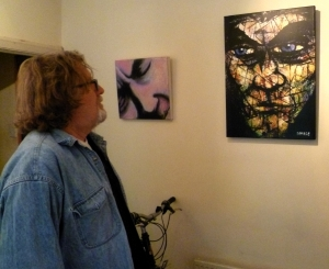 Brian with two of his works. The one on the left is of his father)