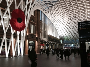 King's Cross station, London, with Remembrance poppy