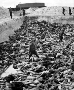 Nazi doctor. Fritz Klein stands amongst corpses in Mass Grave 3 at Belsen