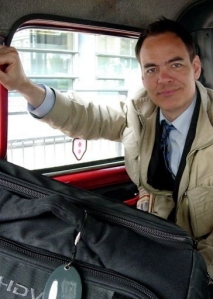 Max Keiser in a taxi in 2007, as the financial markets headed for collapse