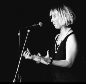 Jenny Eclair performing at The Tunnel club, London, in 1986 (Photograph by Bill Alford)