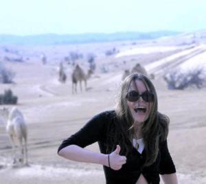 Juliette Burton + camels. We're definitely not in Kansas, Toto.