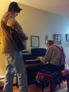 7ft+ Bob plays guitar while Paul accompanies