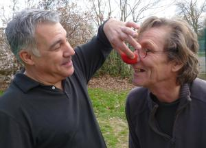Lewis Schaffer (left) tweaks Martin Soan's red nose yesterday