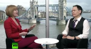 Stacey Herbert with Max Keiser on RT series The Keiser Report