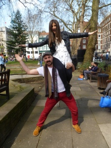 Adam shows off his lady lifting skills in Soho
