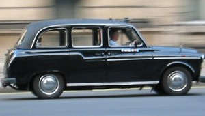 A black cab racing through London with no sign of a glove