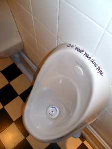 The stand-up urinals in the Gents toilets at Vout-O-Reenee say: ceci n'est pas une pipe