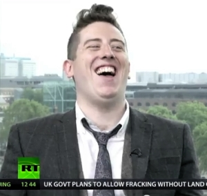 Alex Oates laughs on The Keiser Report