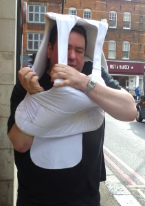 Matt Price demonstrates in a Camden street that the stab vest does not fit
