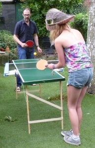 Sybil Soan, in hat, plays ping pong with Edwardian animal impersonator Vincent Figgins
