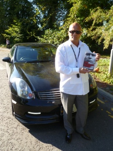 William Lobban with his car and his book yesterday
