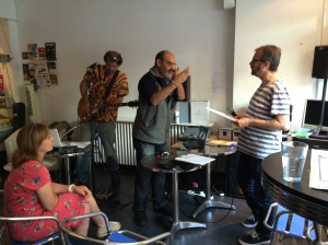The Anti-Duhring Battalion (right, in stripes) supervised the live radio show yesterday