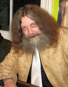 Alan Moore: a man with a fine beard and stick