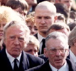 Reg Kray (right) & Charlie Kray (left) at their brother Ronnie's funeral; Steve Wraith is behind.