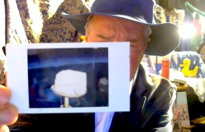The Iceman holds up Block 220 Polaroid