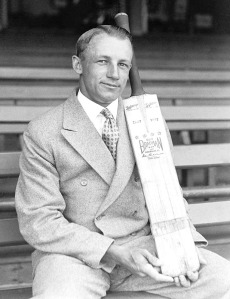 Don Bradman holds a cricket bat