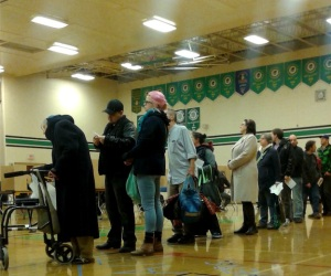 "Socially responsible citizens line up in a Vancouver gym to vote in yesterday's election. Anna says: ""I was told by a polite, pregnant officer that I was not allowed to take this photo."""