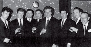 (From left) Teddy Smith, Micky Fawcett, Johnny Davis, Reggie Kray, Freddie Mills, Ronnie Kray, Dicky Morgan, Sammt Lederman at Freddie Mills' Nite Spot in the 1960s (Photograph from Micky Fawcett's book Krayzy Days)
