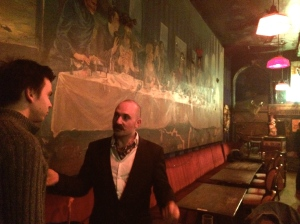 Adam Taffler (right) with Joz Norris under the Last Supper mural