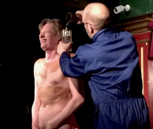 Martin Soan attempts to piss on a member of the audience with help from Dan Lees