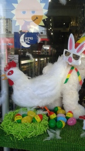 Bear dressed as rabbit standing by a chicken laying marijuana eggs