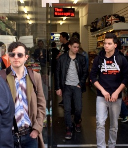 Gareth (left in sunglasses) outside shop with tourist & confectionary materials and Thai Sauna