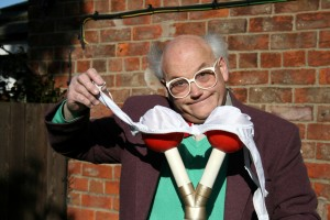John Ward demonstrating his bra-warming device