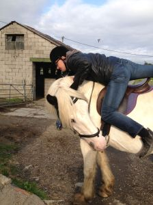 Dec Munro attempts to mount a horse
