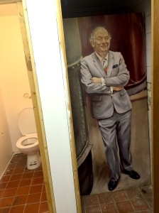 Painting of John Young inside stables urinal