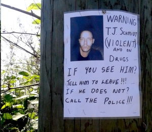 Notice on tree in Vancouver about a dangerously violent man