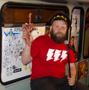Bob Slayer on the bus with his Flying Fuck Award
