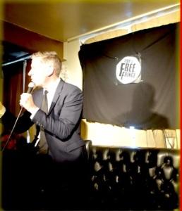 David Mills with a misunderstood flag behind him (Photograph by Sandra Smith)|