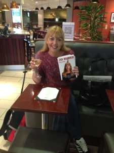 Jo Burke with butterflies and Prosecco a London City Airport