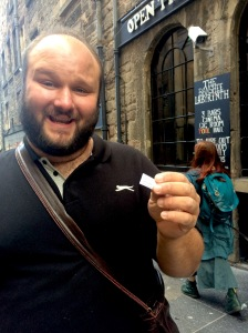 Mark Dean Quinn holds a flyer for his show