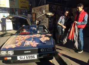 Nathan (right, in red) with his de Lorean